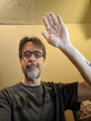 Ray raising his hand